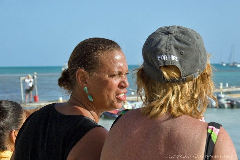 Winnie and Nancy watching the Dark and Stormy lay day dinghy races at Neptune's Treasure.