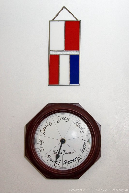 """HT"" nautical signal flag stained glass hanging above our Hidden Treasure clock. The stained glass was a housewarming gift from some very good friends. Thanks Beth, Gary, Tyler, and Connor Thiret!