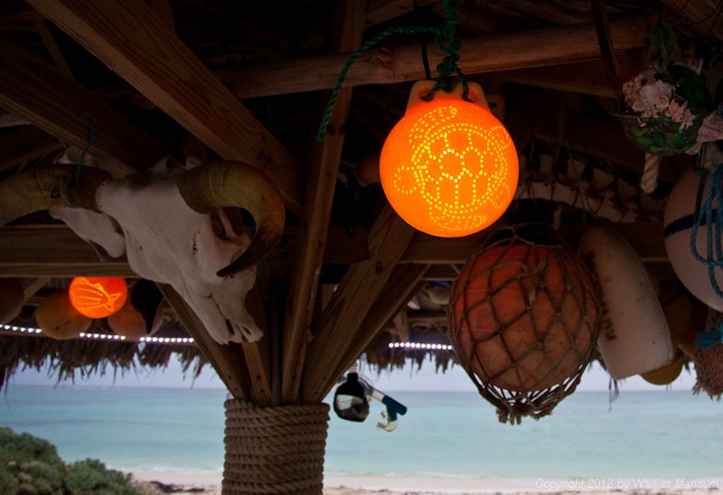 A little bit of island art. Fishing floats from the beach become palapa lights.